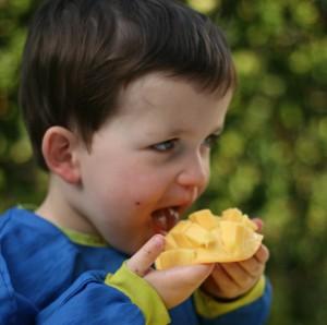 Jake eating mango